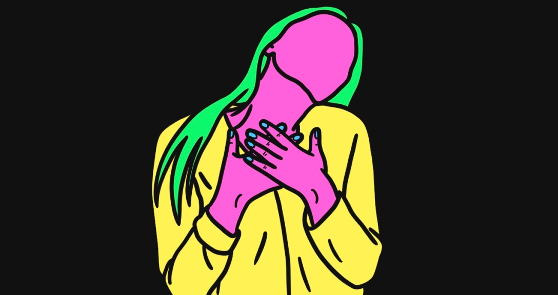 Pink person with neon green hair is leaning their head on their left shoulder, hands covering their chest. They are wearing a yellow cardigan.