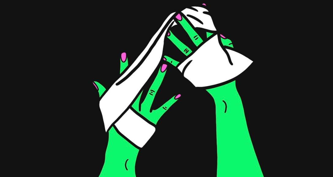 Green hands with neon pink nails are wrapped in white fabric.