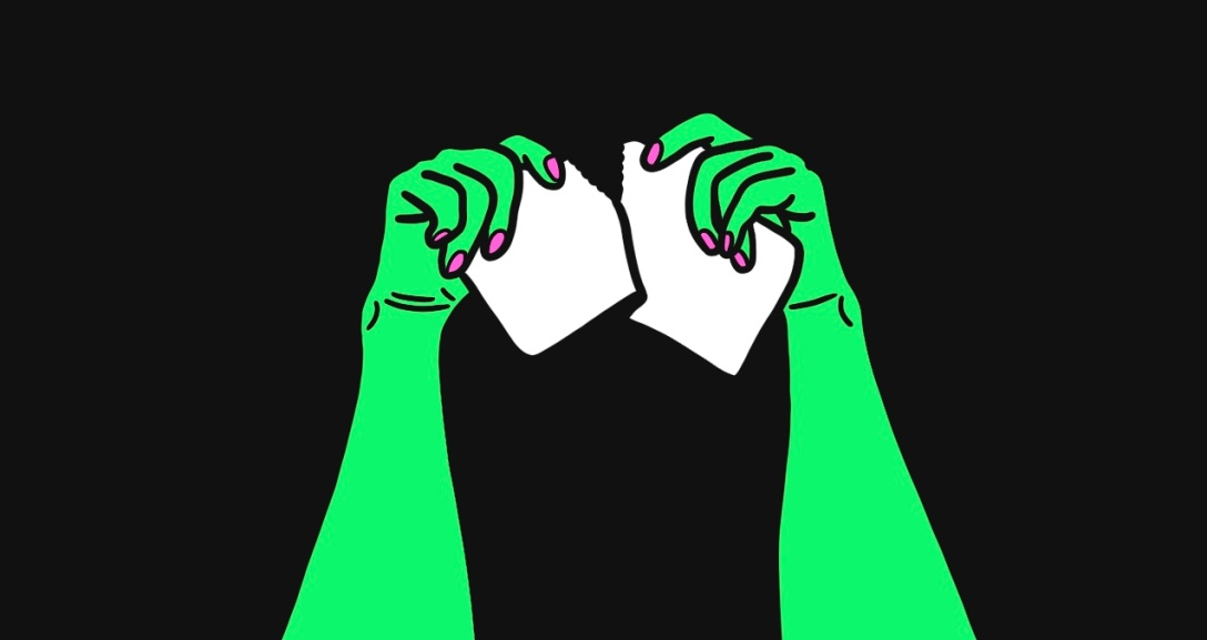 Green hands are tearing a piece of white paper apart.