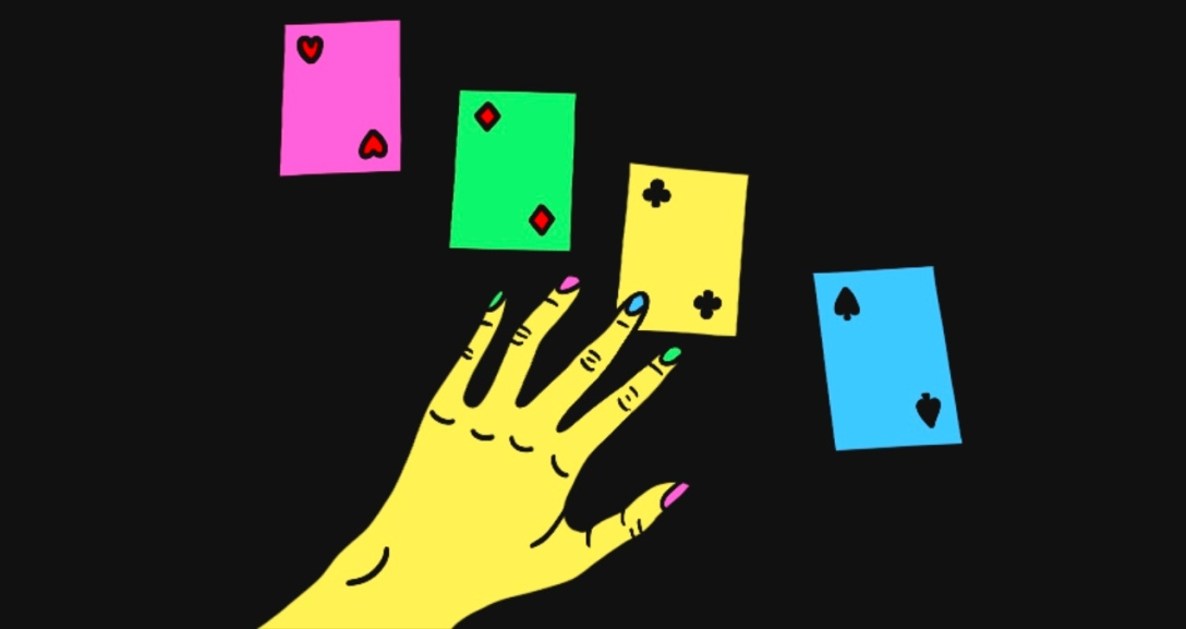 Yellow hand with neon pink, green and blue nails is hovering over 4 cards (one of each suit).