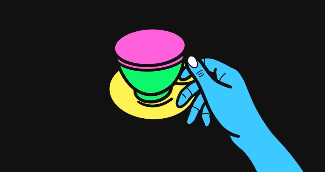 Blue hand is holding onto a cup of coffee. The cup is green and pink and the saucer is yellow.