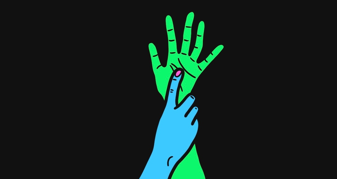 A green hand held up mid-air whilst a blue hand grips onto its wrist with a finger pressing against their palm. Their nails are painted neon pink.