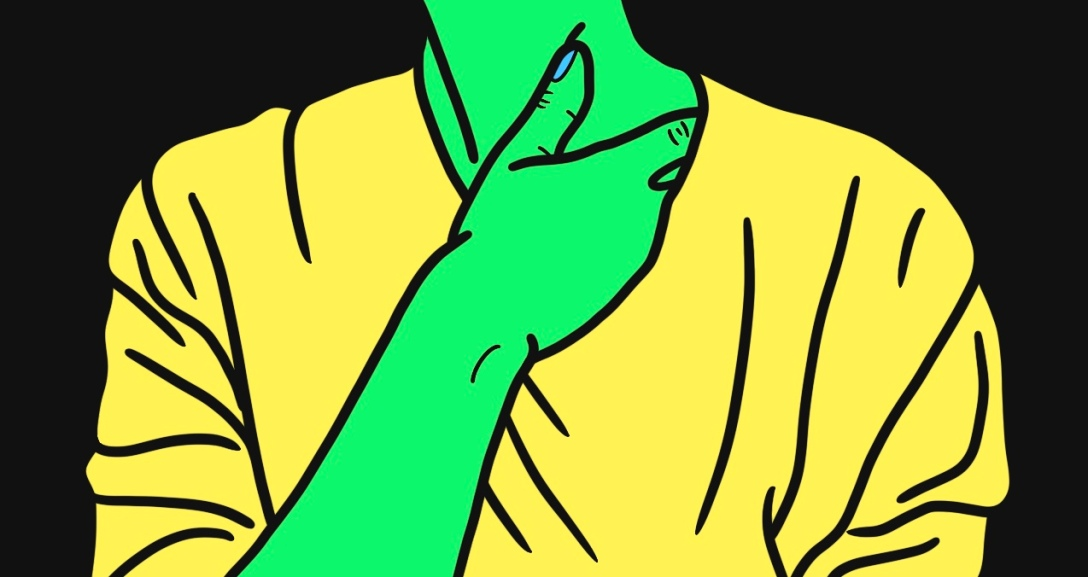 Green person with their hand slipped under the collar of their neck. They are wearing a yellow top.