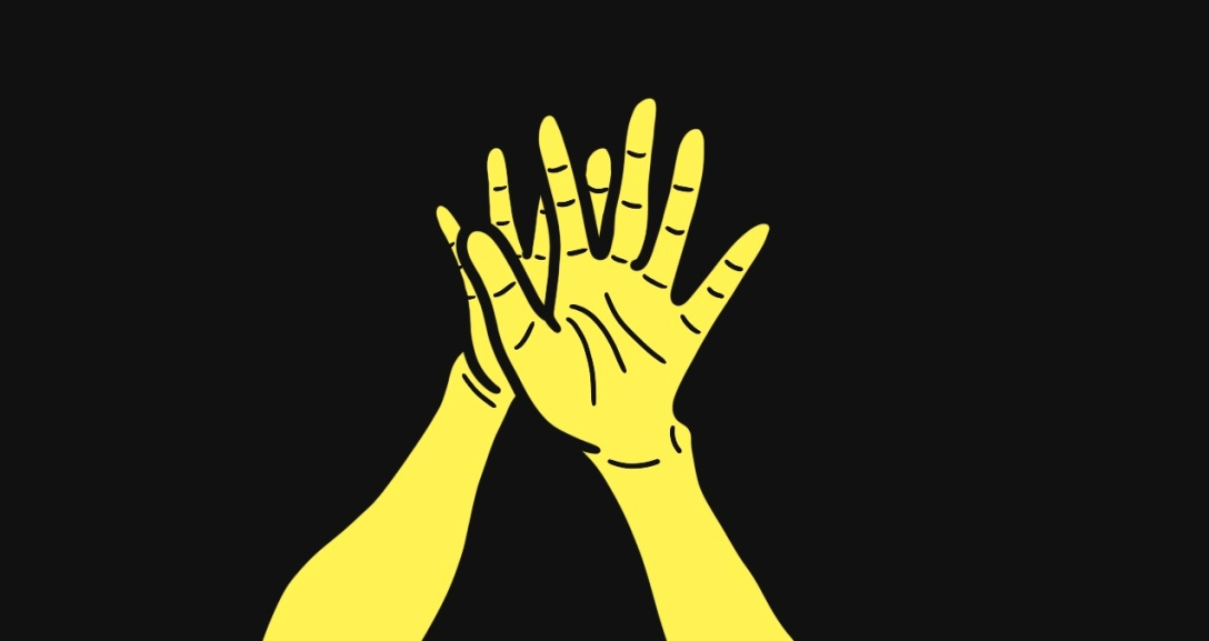 The back of one yellow hand placed over another.