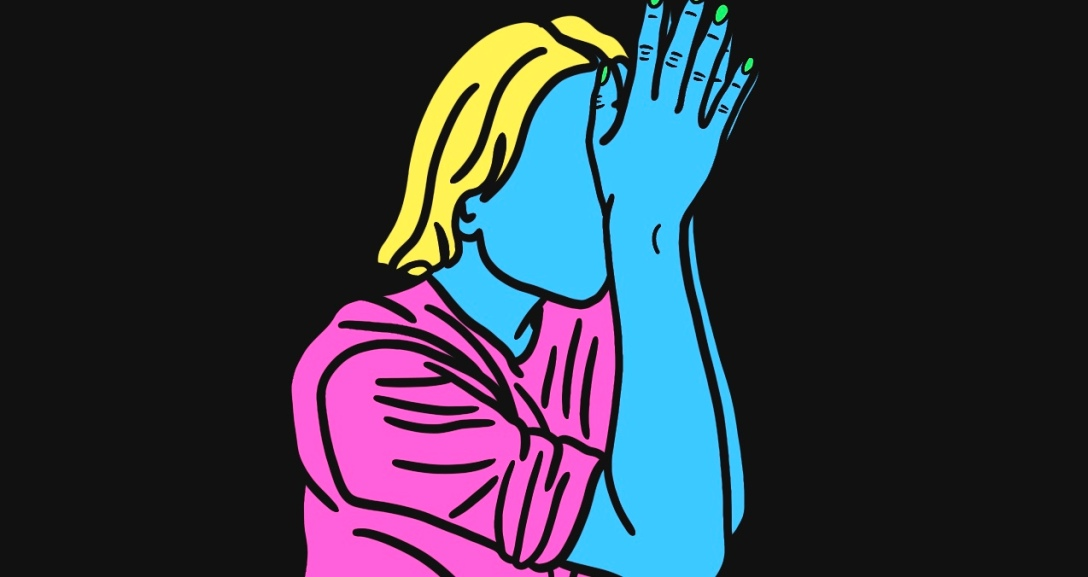 Blue person leaning their forehead into their hands. They have short, blonde hair and is wearing a pink top.