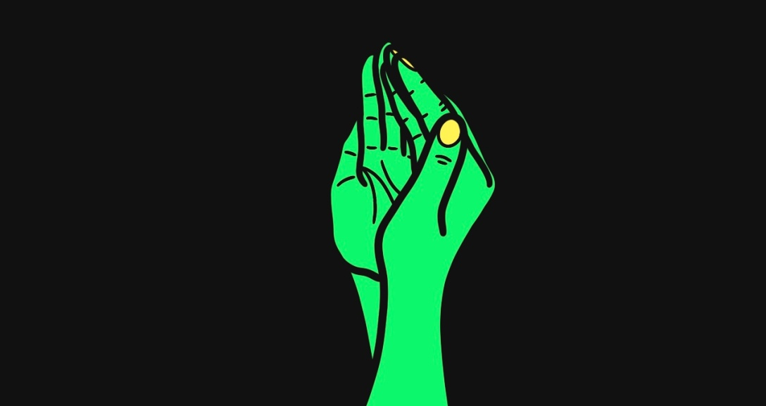 The image shows a black background with a pair of green hands, fingers pressed together and hands curved from the side, with yellow fingernails.
